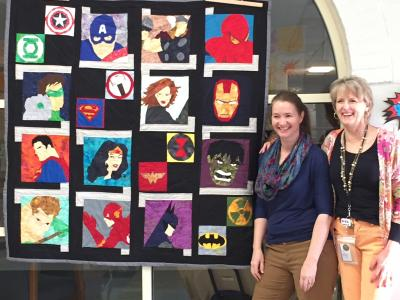 PIcture of quilt with creators Aimee Rand and Nicole Bracken