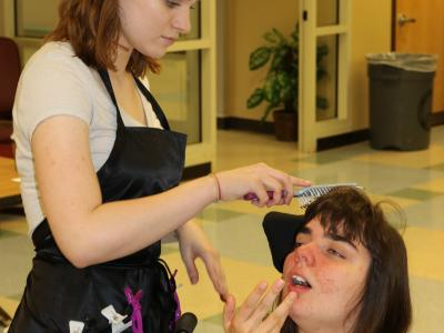 Students from Lee HS cosmetology program came to help with hair, makeup and nails